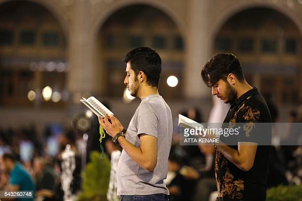 Iranian Shiite Muslims pray at the Imam Khomeini grand mosque in the capital Tehran in the early hours of July 27 2016 in commemoration of the death...