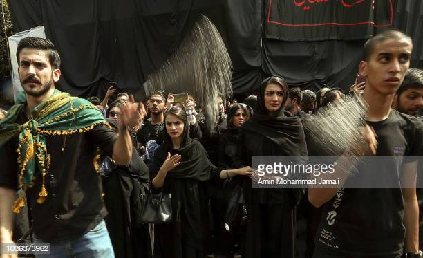 Iranian Shiite Muslims pray in Tehran during annual Ashura commemorations marking the martyrdom of Imam Hussein the grandson of Islam's Prophet...