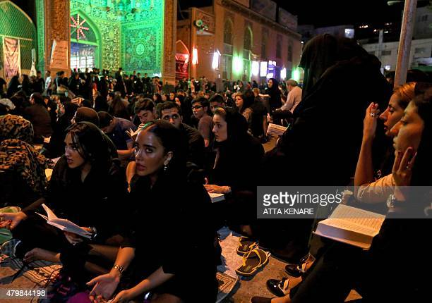 Iranian Shiite Muslims pray in Tehran early on July 7 2015 in commemoration of the death of the seventh century Imam Ali bin Abi Taleb and in...