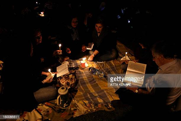 Iranian Shiite Muslims pray in Tehran in the early hours of August 10 2012 in commemoration of the death of the seventh century Imam Ali bin Abi...
