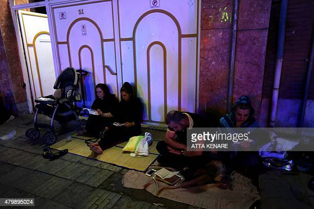 Iranian Shiite Muslims pray in Tehran in the early hours of July 7 2015 in commemoration of the death of the seventh century Imam Ali bin Abi Taleb...