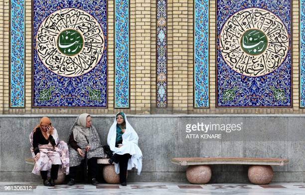 Iranian Shiite Muslims sit at the Emamzadeh Saleh mosque in Tajrish square in northern Tehran on May 22 during the Muslim holy fasting month of...