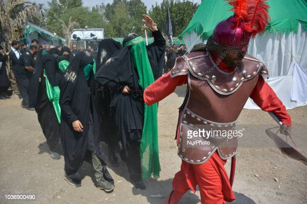 Iranian Shiites in costumes reenact events of Ashoura in Tehran Iran Thursday Sept 20 2018 Ashoura is the annual Shiite commemoration of the death of...