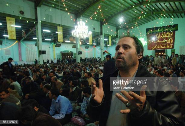 Iranian Shiites pray at the Jamkaran Mosque December 6 2005 in Jamkaran Iran Some Iranian Shiites believe and are waiting for the return of the Mahdi...