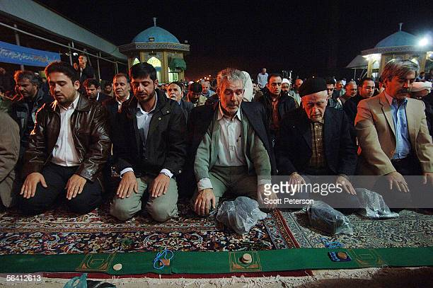 Iranian Shiites spill oustside of the Jamkaran Mosque to pray December 6 2005 in Jamkaran Iran Some Iranian Shiites believe and are waiting for the...
