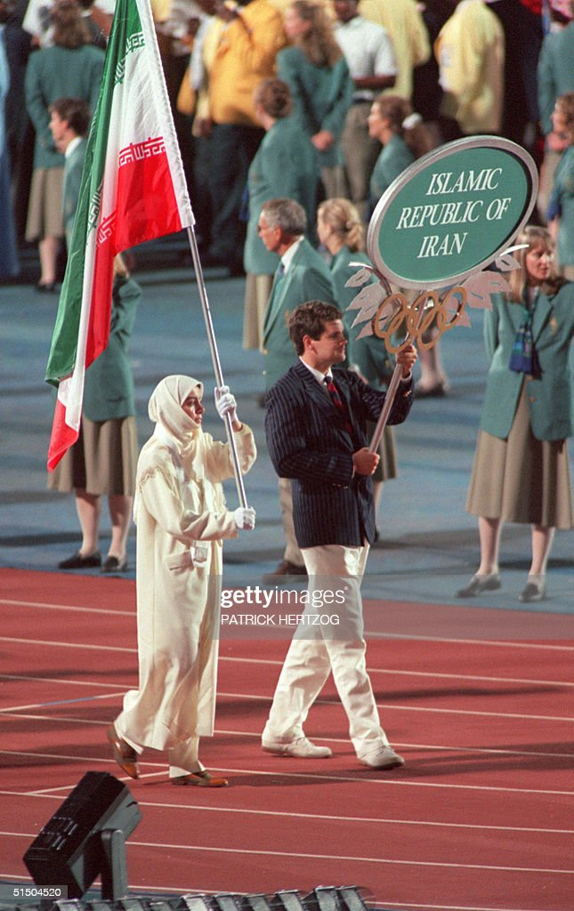Iranian shooter Lida Fariman carries her delegatio : News Photo