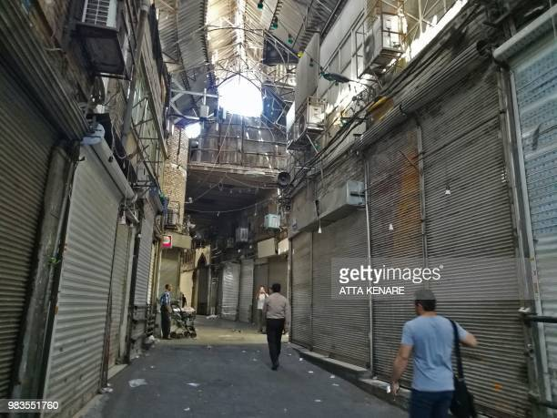 Iranian shop closed at the ancient Grand Bazaar in Tehran on June 25 2018 Grand Bazaar shop owners closed their shops on monday in a rare strike...
