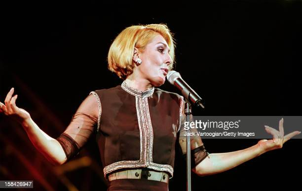 Iranian singer and actress Faegheh Atashin, who uses the stage name Googoosh, performs at Nassau Coliseum, Uniondale, New York, August 26, 2000.