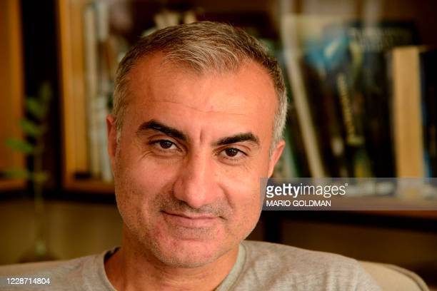 Iranian singer Omid Tootian poses for a picture during an interview at a coffee shop in the UN-controlled buffer zone in the Cypriot capital Nicosia,...