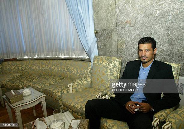 Iranian soccer star Ali Daei waits in Tehran 14 July 2004 to meet Iranian President Mohammad Khatami before leaving Tehran with his team for Beijing...