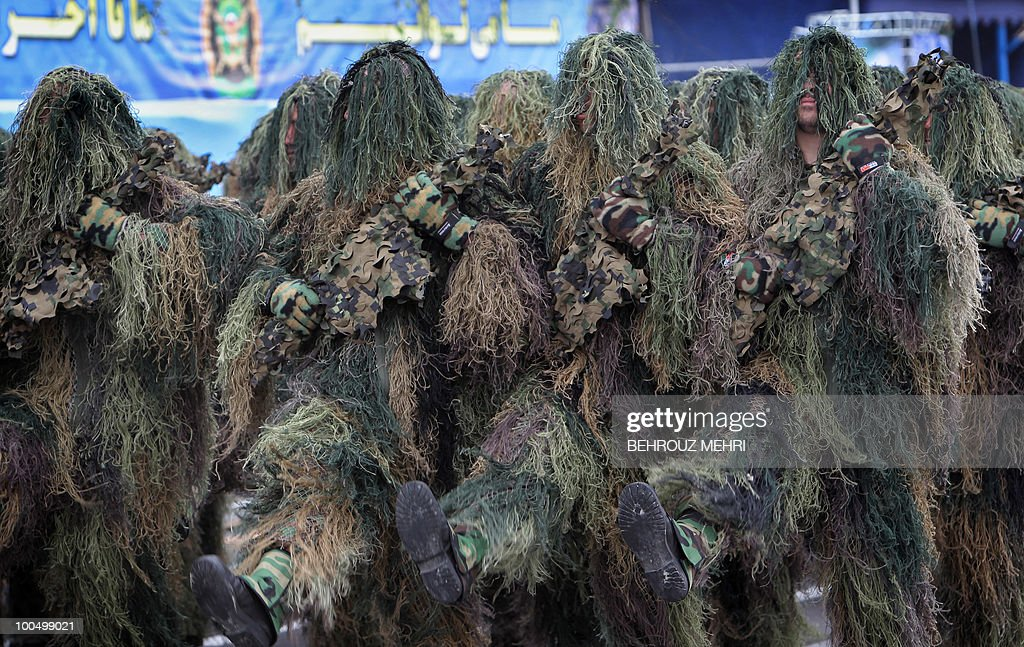Iranian soldiers in full camouflage march during the Army Day parade in Tehran on April 18, 2010. President Mahmoud Ahmadinejad said that Israel was on its way to collapse, as Iran's military displayed a range of home-built drones and missiles at the annual Army Day parade.