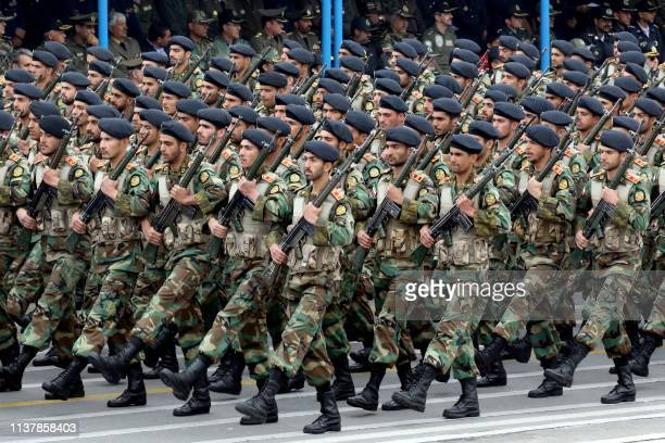 Iranian soldiers march during a military parade as they mark the country's annual army day in Tehran, on April 18, 2019. - Iran's President Hassan...
