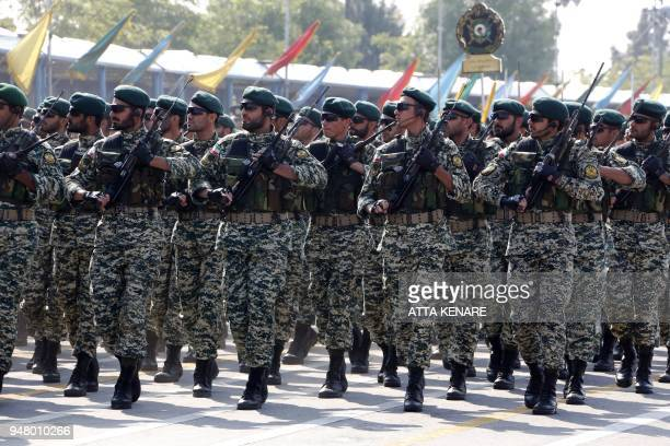 Iranian soldiers march during a parade on the occasion of the country's annual army day on April 18 2018 in Tehran President Hassan Rouhani said...