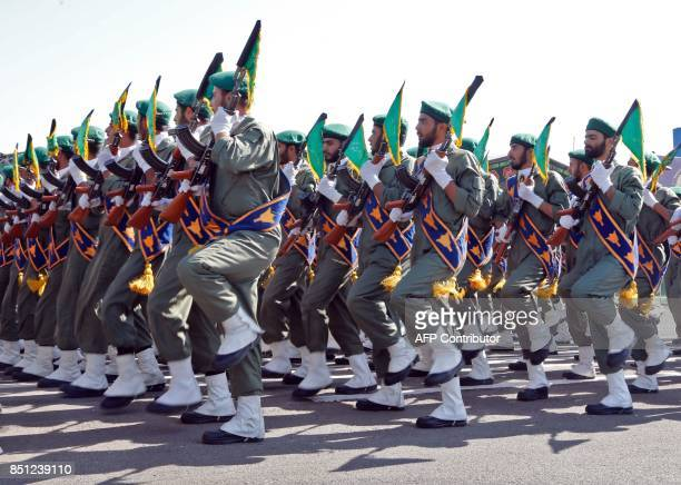 Iranian soldiers march during the annual military parade marking the anniversary of the outbreak of its devastating 19801988 war with Saddam...