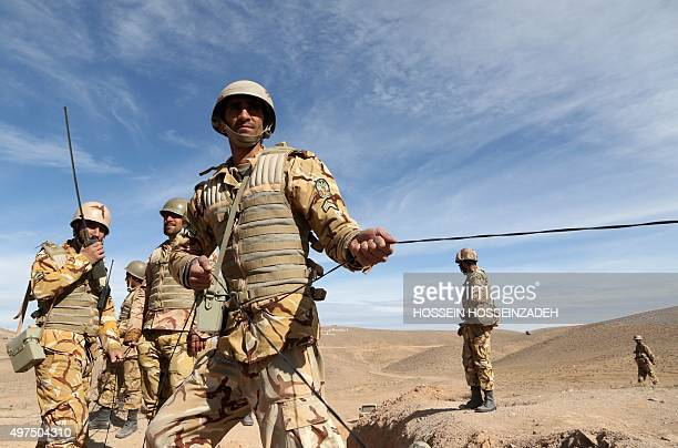Iranian soldiers participate in military manoeuvres on the outskirts of the northeastern Iranian town of TorbatEJam near Mashhad on November 17 2015...