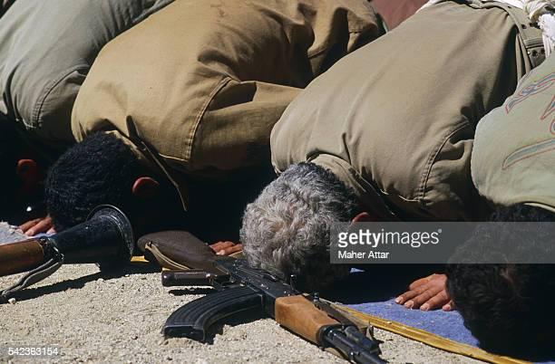 Iranian soldiers praying during operation Nasser VII, northwest of the Irano-Iraqi front.   Location: Sardacht Region, Iran.
