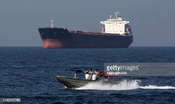 Iranian soldiers take part in the National Persian Gulf day in the Strait of Hormuz on April 30 2019 The date coincides with the anniversary of a...