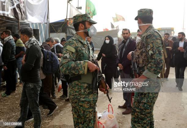 Iranian soldiers watch Shiite Muslim pilgrims at the Iranian-Iraqi Mehran border as they head towards the central Iraqi shrine city of Karbala on...