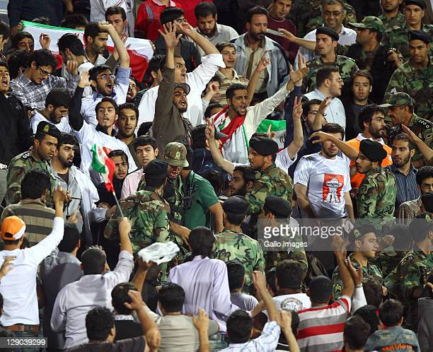 Iranian spectators chant during the 2014 World Cup Asian qualifying match between Iran and Bahrain at Azadi Stadium on October 11, 2011 in Tehran,...