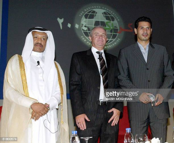 Iranian striker Ali Daei poses with Tony Martin the chairman of Soccerex after he received a special award from AFC president Mohammed bin Hammam for...