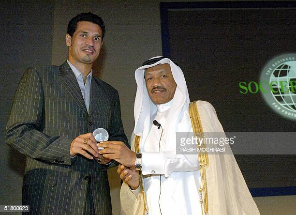 Iranian striker Ali Daei receives a special award from AFC president Mohammed bin Hammam for holding the record of goals at the international level...