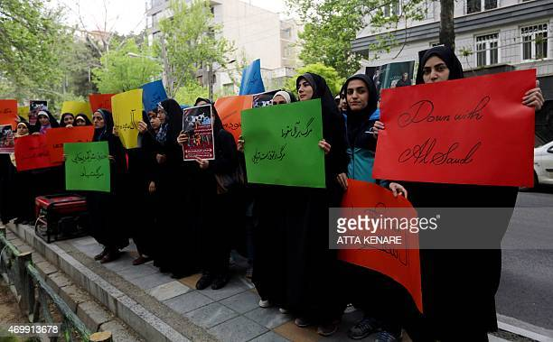 Iranian students hold placards during a demonstration against the Saudiled coalitions operation against the Iranbacked Shiite rebels in Yemen on...