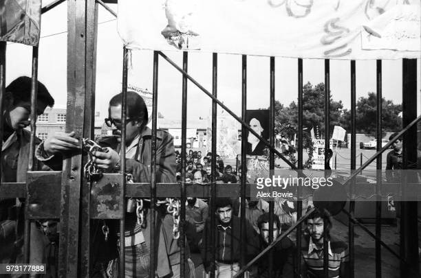 Iranian students padlock the gates of the US Embassy compound while colleagues gather for morning prayers a month into the Iran Hostage Crisis as 52...