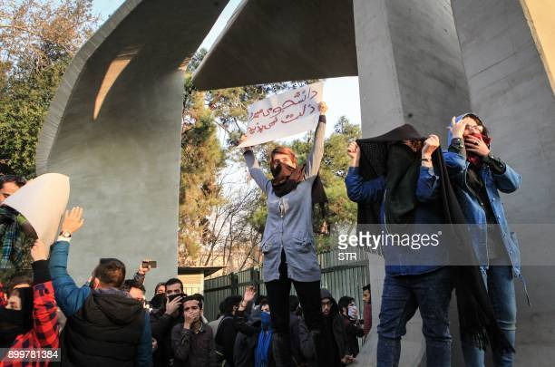 Iranian students protest at the University of Tehran during a demonstration driven by anger over economic problems in the capital Tehran on December...