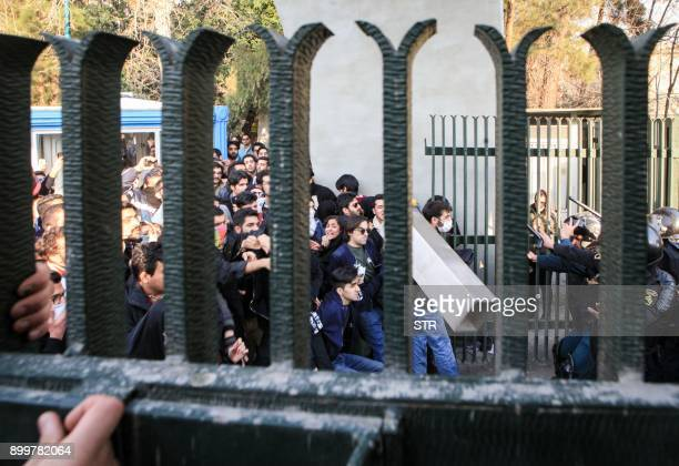 Iranian students scuffle with police at the University of Tehran during a demonstration driven by anger over economic problems in the capital Tehran...
