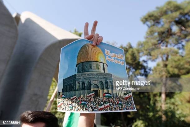 Iranian students stage a protest outside Tehran University on July 25 2017 against Israeli security measures implemented at the alAqsa mosque...
