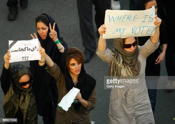 Iranian supporters of defeated reformist presidential candidate Mir Hossein Mousavi demonstrate as a woman carries a sign saying 'where is my vote'...