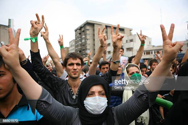 Iranian supporters of defeated reformist presidential candidate Mir Hossein Mousavi demonstrate in the streets on June 15 2009 in Tehran Iran Crowds...