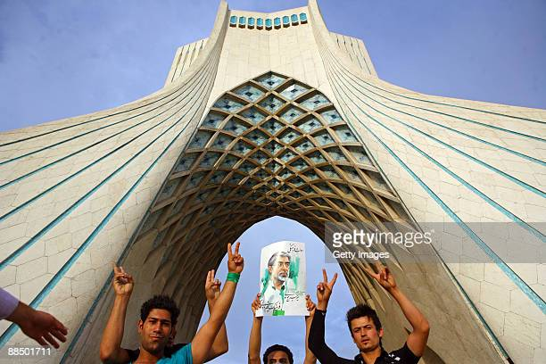 Iranian supporters of defeated reformist presidential candidate Mir Hossein Mousavi carry his image as they demonstrate in the streets on June 15...