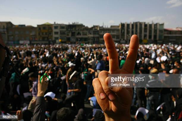 Iranian supporters of defeated reformist presidential candidate Mir Hossein Mousavi demonstrate on June 18 2009 in Tehran Iran Thousands of people...