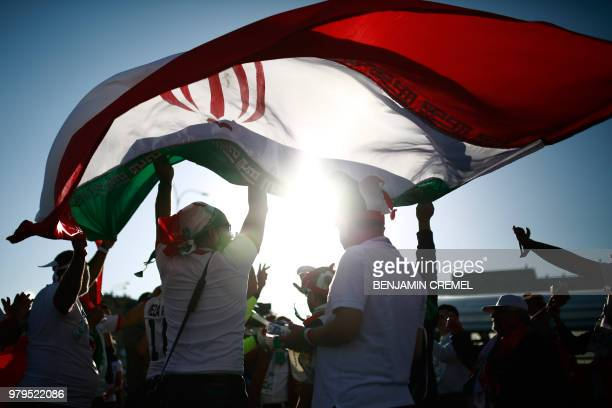 Iranian supporters wave the national flag ahead of the Russia 2018 World Cup Group B football match between Iran and Spain at the Kazan Arena in...