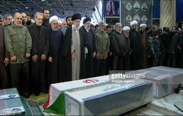 Iranian Supreme Leader Ayatollah Ali Khamenei and Iranian President Hassan Rouhani attend the funeral ceremony of Qasem Soleimani commander of...