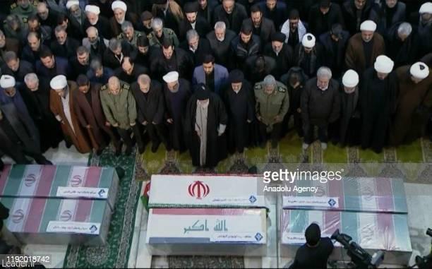 Iranian Supreme Leader Ayatollah Ali Khamenei and Iranian President Hassan Rouhani attend the funeral ceremony of Qasem Soleimani, commander of...