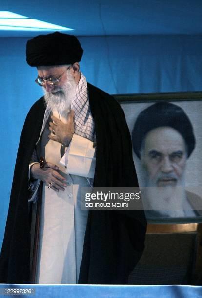 Iranian supreme leader Ayatollah Ali Khamenei attends a ceremony marking the 15th anniversary of the death of his predecessor Ayatollah Ruhollah...