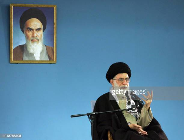 Iranian supreme leader Ayatollah Ali Khamenei delivers his speech under a portrait of Iran's late founder of Islamic Republic, Ayatollah Khomeini in...