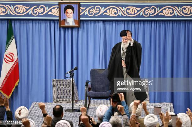 Iranian Supreme Leader Ayatollah Ali Khamenei greets people as he attends a meeting to speak on missile attacks on US bases in Iraq in Tehran Iran on...