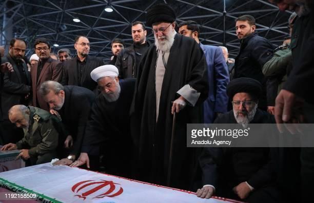 Iranian Supreme Leader Ayatollah Ali Khamenei Iranian President Hassan Rouhani and Iranian Parliament Speaker Ali Larijani attend the funeral...