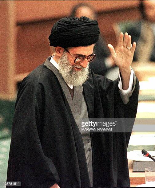 Iranian supreme leader Ayatollah Ali Khamenei salutes delegates of the Organisation of the Islamic Conference summit in Tehran 09 December after...