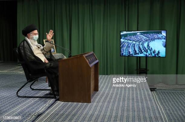 Iranian Supreme Leader Ayatollah Ali Khamenei, wearing a medical mask, attends the meeting of Iranian Parliament via video conference call in Tehran,...