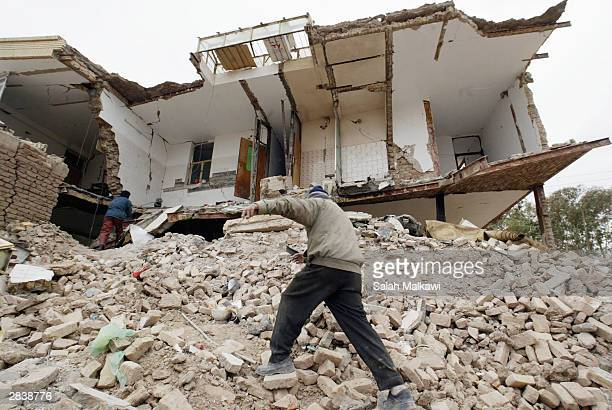 Iranian survivers of the earthquake search between the debris of their home December 31 2003 in Bam Iran As bodies continue to be pulled from rubble...