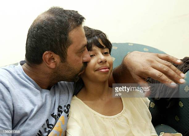 Iranian survivors Mohammad is reunited with his daughter Athena Hardani for the first time at a hotel in the town of Juanda in Indonesia's East Java...