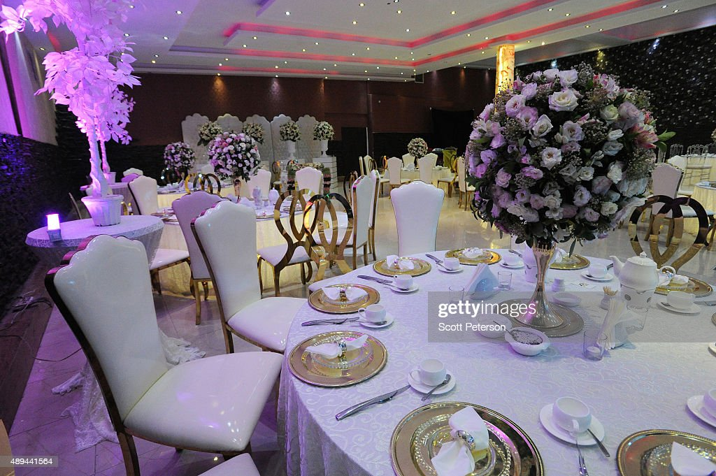 Iranian tables are prepared for a luxury wedding with mixed dancing and removal of headscarves, at a private garden tailor-made for the purpose west of Tehran, Iran, on September 14, 2015. Such weddings are booming business in Iran with an average price tag of $20,000, though they also often break Islamic rules and can be shut down by police if they do not have a permit.