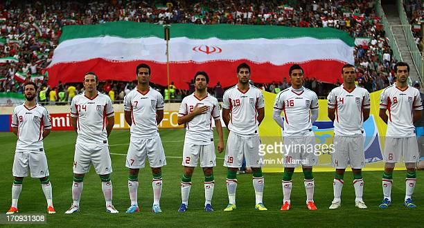 Iranian team line up for national anthems during the FIFA World Cup Asian Qualifier between Iran and Lebanon at Azadi Stadium on June 11 2013 in...