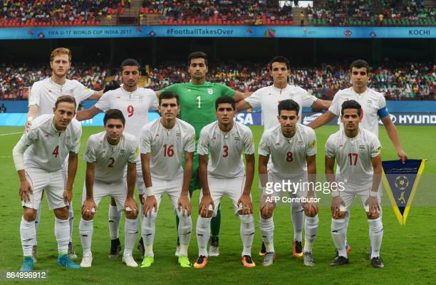 Iranian team pose for a group photograph prior to the start of their quarterfinal football match of the FIFA U17 World Cup at the Jawaharlal Nehru...
