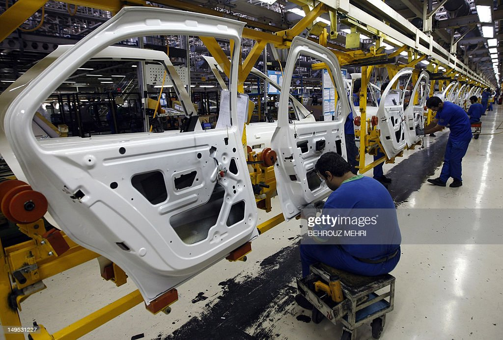 Iranian technicians work on parts for Peugeot 206 cars at the Iran Khodro auto plant, west of Tehran, on September 30, 2008. The chairman of Iran's biggest car maker accused France of 'inappropriate policies', which he said are hampering joint ventures in a country where French manufacturers have a 40 to 50 percent market share. In July, IKCO, Iran's biggest car company, celebrated the 20th year of cooperation with Peugeot, whose 405 and 206 ranges it manufactures under licence.
