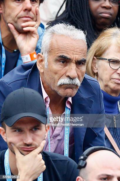 Iranian Tennisman Mansour Bahrami is watching the match between Richard Gasquet and Andy Murray during the French Tennis Open at Roland Garros on...